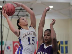 Cary Academy's Mickayla Sanders (15) goes up for the layup over Holly Spring's Kiara Leslie (5) in the HighSchoolOT.com Holiday Invitational at Cary Academy Thursday morning (photo by Wes Hight).
