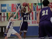 Images from Holly Springs' 62-49 victory over Cary Academy in the consolation portion of the Mix 101.5 Girls Bracket of the HighSchoolOT.com Holiday Invitational.