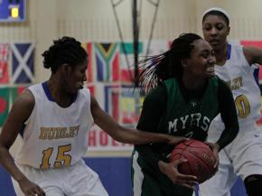 Myers Park's India Timpton (22) tries to keep possession of the ball at the HighSchoolOT.com Holiday Invitational Thursday afternoon at Cary Academy.  Myers Park defeated Dudley 63-58 (photo by Wes Hight).