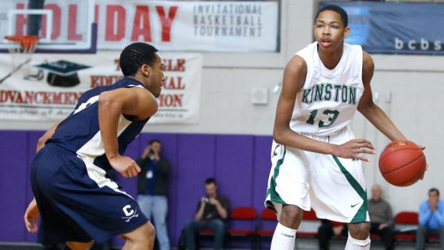 Kinston's #13 Brandon Ingram looks to pass the ball at the HighSchoolOT.com  Holiday Invitational Tournament December 28, 2012. (Photo by Jack Tarr)