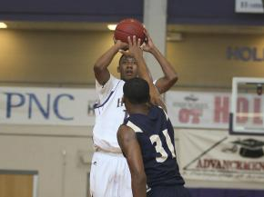 Holly Springs' Craig McDaniel (11) gets a jumper off over  Cutherbertson's Isiah Cureton (31) in 3rd place game of the HighSchoolOT.com Holiday Invitational, December 29, 2012.