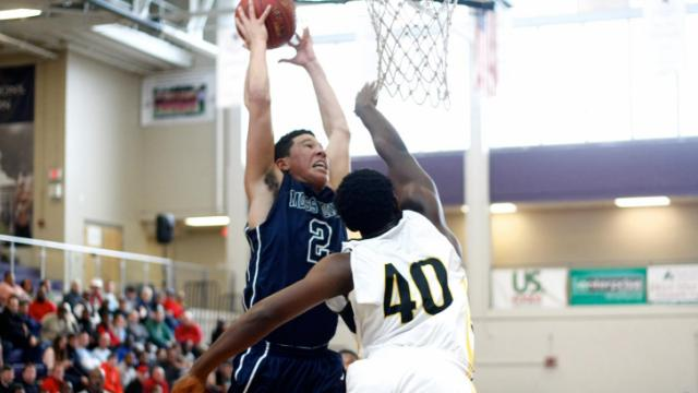 Devin Booker (2) grabs a rebound. Apex defeated Moss Point 64-59 in the first round of the HighSchoolOT.com Holiday Invitational in Raleigh, NC on December 26, 2013. Photos by: Jerome Carpenter