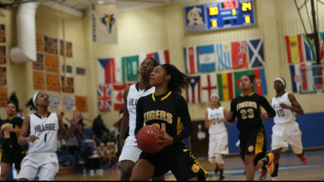 Chapel Hill High's Raziyah Farrington drves the lane. The Tigers of Chapel Hill High School defeated the Durham Hillside Hornets 57-40 in the first round HSOT.com Holiday Tournament girls bracket played at Cary Academy on December 26, 2013. Photo by Dean Strickland OD.