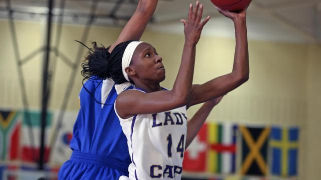 The Lady Caps from Broughton High School defeated the Dudley High School Panthers 59-52 in a first round game of the HSOT.com Holiday Tournament played at Cary Academy on December 26, 2013. Photo by Dean Strickland OD.