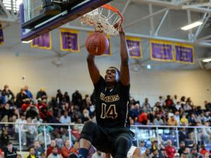 Elijah Staley (14) with the dunk.  Wheeler Wildcats from Georgia beat North Carolina's Garner Trojans 86 to 60 on the first day of the HSOT holiday invitational tournament.  (Photo by: Suzie Wolf/WRAL contributor)