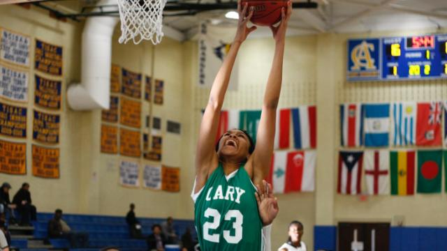 Azura Stevens (23) grabs one of her 27 rebounds. Cary defeated Hillside 61-58 on the second day of the HighSchoolOT.com Holiday Invitational in Raleigh, NC on December 27, 2013. Photo by: Jerome Carpenter