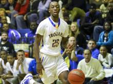 Garner's boys basketball team took control of the Greater Neuse River Conference with a tough win over Clayton.