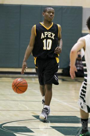 Apex's #10 T.J. Wells brings the ball up court during the game Tuesday January 29, 2013. (Photo by Jack Tarr)