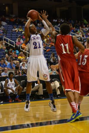Broughton guard Devonte Graham attempts a midrange jump shot.