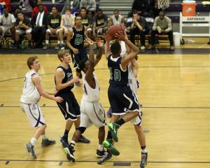 Brandon Staves (10) charges the lane. Broughton High School hosts Leesville Road High School in Raleigh N.C. on Wednesday February 5, 2014. After a tight game, Leesville forced overtime and edged Broughton by a score of 59-52. (Chris Baird / WRAL Contributor).