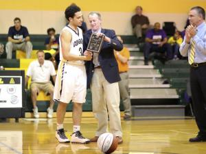 "T.J. Evans (3) awarded the ""Southwest Wake Player of the Year"" plaque. Riverside High School travels to Apex N.C. for round 1 of the high school play offs. Apex started strong and never looked back topping Riverside by a score of 72-52. (Chris Baird / WRAL Contributor)."