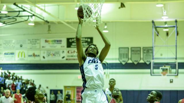 Rob Brown (5) with the put back.  Millbrook High School beats Seventy First High School from Fayetteville with a score of 83 to 61.    (Photo by: Suzie Wolf/WRAL contributor)
