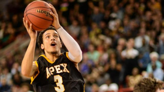 TJ Evans (3) coming in to the basket.  Apex High School plays Lake Norman High School for the 4A boys state finals: Apex wins with a score of 62 to 59 at Reynolds Coliseum, North Carolina State, Raleigh North Carolina.  (Photo by: Suzie Wolf/WRAL contributor)