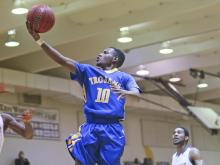 Garner High's Julius Barnes (10) goes in for a layup. The Trojans of Garner High School defeated the Warriors of East Wake High School  74-66 in overtime played in Wendell, N.C. on January 23, 2015. (Photo By: Dean Strickland, OD/HighSchoolOT.com Contributor)
