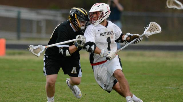 Middle Creek's Justin Medwar brings the ball up the field in overtime. Middle Creek's boy's lacrosse team defeated Apex 9-8 in overtime on Monday, April 28, 2014. (Photo By: Nick Stevens/HighSchoolOT.com)