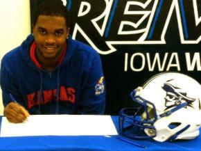 Former Panther Creek player Isaiah Johnson signs with Kansas.