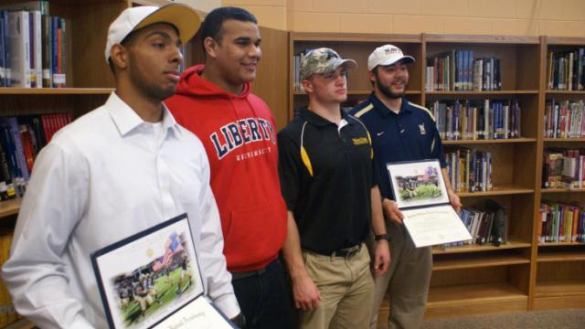 Panther Creek football players Terrence Laster, Gregg Storey, Justin Byers and J.T. Wise signed National Letters of Intent on Wednesday afternoon.