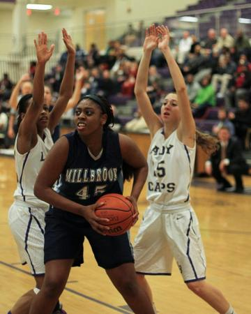 Ryan Flowers (45) with the rebound for Millbrook. Broughton hosts Millbrook on Thursday January 31, 2013 in Raleigh NC. Millbrook Ladies walk away with victory 47 to 56. Photo by CHRIS BAIRD