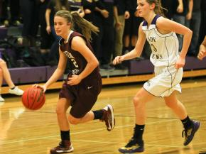 Green Hope's #22 Ashley Williams (C) dribbling the ball during the game Thursday January 31, 2013. (Photo by Jack Tarr)