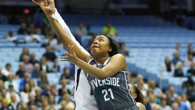 Riverside's Kayla Jones attemps a shot against Bishop McGuinness in the 1A women's title game on Saturday, March 15, 2014.