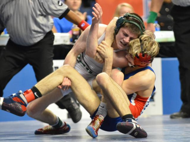 Drew Turner (Parkland) beat Nick Tarvin (Cary) to win the 113: Class 4-A. NCHSAA State Wrestling Championships were taken place at The Greensboro Coliseum on Saturday, February 22, 2014. (Photo By: Beth Jewell)