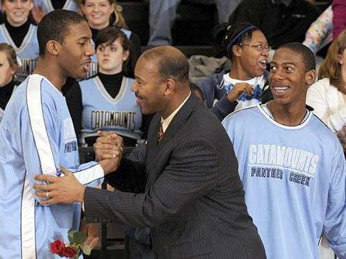 Panther Creek's Marques and Brandon Oliver celebrate Senior Night with their father before a game against Athens Drive on Friday, February 6, 2009. Panther Creek won 50-30. (Photo by Grant Halverson)