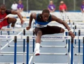 Wayne David jumping a hurdle (Photo courtesy: VYPE High School Sports Magazine/Wayne Davis)