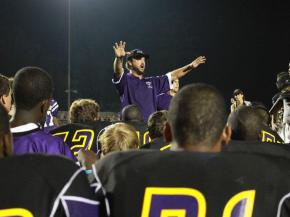 Head Coach Jason Tudryn addresses his team after Carrboro High School improved to 2-0 after a 30-0 victory over Orange High School on Friday, Aug. 27. (photo by Will Okun)