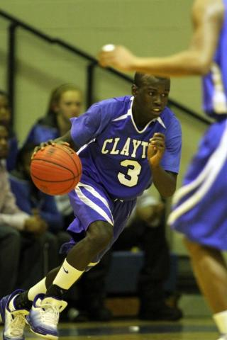 Clayton's #3 Anthony Gaskins dribbles up court. Garner Boy's defeat Clayton in a close game 80 to 77 Tuesday evening December 14, 2010.