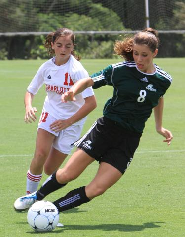 #8 Morgan Reid steals the ball during Charlotte Catholic High School's 2-1 victory over Cardinal Gibbons High School to win the 2011 NCHSAA 3-A Women's Soccer Championship on Saturday, May 28. (photo by Will Okun)