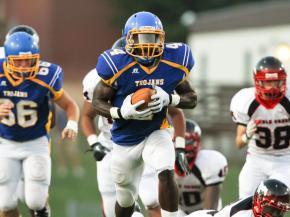 Garner senior Demetrius Fairley #4 runs in for a touchdown as Garner defeats Middle Creek 35 to 21 Friday night September 9, 2011 at Garner high school in Garner, NC.