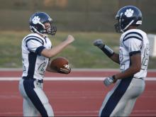 Ryan Trocinski (21) and Sam Blue (82) celebrate a touchdown during the Millbrook vs. Northern Durham game on September 9, 2011 in Durham, North Carolina.