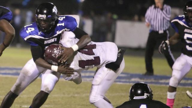 Hunts WR Dexter Wright # 14 on the tackle.Hunt defeats Nash Central 23-21 at Hunt High School Stadium in Wilson North Carolina.