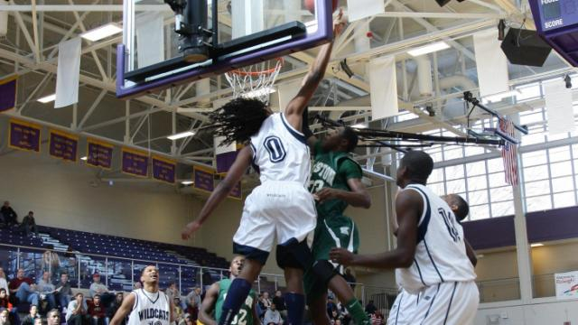 Wheeler's  KEJUAN JOHNSON (#0) blocks a shot as Kinston defeats Wheeler 59 to 51 during the 2011 HighSchoolOT.com Holiday Invitational  tournament Wednesday December 28, 2011.