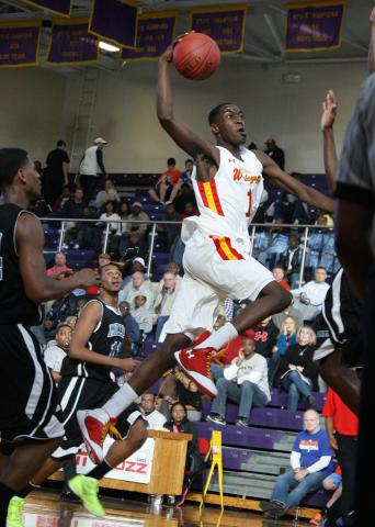 Wesleyan's  Theo Pinson (#1) goes in for the dunk as Wesleyan defeats Miller School 69 to 54  during the  2011 HighSchoolOT.com Holiday Invitational Basketball tournament Wednesday December 28, 2011.