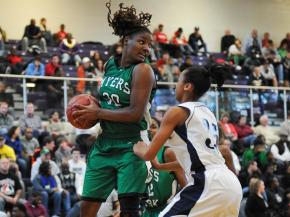 Roddreka Rogers (30) gets the rebound.  Myers Park beats Millbrook 50 to 45 in the Girls Championship December 28, 2011.