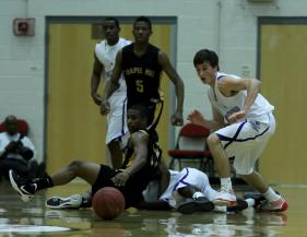 A scramble for a loose ball during the 2011 HighSchoolOT.com Holiday Invitational Basketball tournament Friday December 30, 2011.
