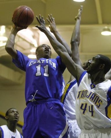 Clayton's Gary Clark (11) goes up for a shot as Garner's Cameron Redd (44) puts a hand in his face. Garner won the the Greater Neuse River Conference Tournament Championship played at Garner High School Friday, February 17, 2012 beating Clayton 70-68. Photo by Dean
