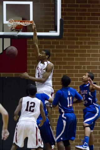 Webb's #4 Isaiah Hicks finshes the play with a dunk in their victory over Asheboro, winning 72-56 (photo by Wes Hight).