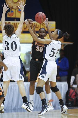 South View's Kanesha Lankford (30) gets the pass between Millbrook's Alex Tomlinson (30) and Bria Day (55). Millbrook became the NCHSAA 4A Girls Eastern Champion with the win over South View 54-49 at Crown Arena. Photo by Dean Strickland OD.