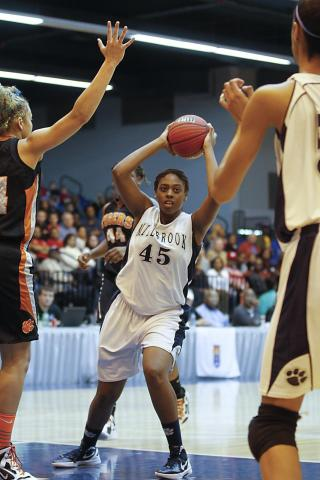 Millbrook's Ryan Flowers (45) looks to pass inside to teammate Briana Day (50). Millbrook became the NCHSAA 4A Girls Eastern Champion with the win over South View 54-49 at Crown Arena. Photo by Dean Strickland OD.