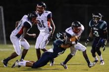 Rahim Winston (1) trying to break a tackle.  Leesville High School beats Jordan High School with a schore of 49 to 0.
