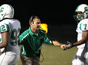 Cary Head Coach Ben Kolstad congratulates his players as Cary defeats Holly Springs 14 to 7 Friday night August 31, 2012. (photo by Jack Tarr)