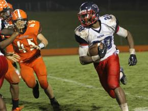 #20 John Brown turns the corner during Orange High School's 26-6 victory against Jordan High School on Friday, Sept. 7 (photo by Will Okun).