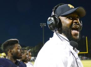 E. E. Smith's head coach Duran McLaurin yells instruction to his players during the game against Douglas Byrd HS on Friday, September 7, 2012.