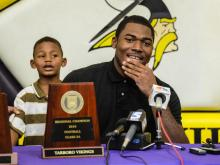 Tarboro defensive end Tyquan Lewis verbally committed to Ohio State on Thursday, Sept. 20, 2012, during a press conference at Tarboro High School.