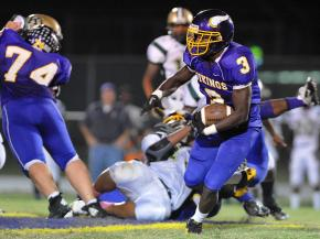 Quentin Robertson #3 carries the ball up the middle during tonights game. Tarboro defeats Kinston 34-27 in Tarboro North Carolina.