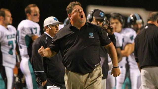 Assistant head football coach Jimmy Williams coaches from the sideline as West Johnston defeated Harnett Central 23-21. Photo By CHRIS BAIRD