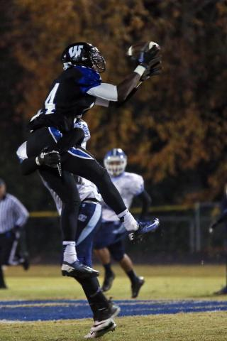 Hunt receiver Dexter Wright (14) can't make the catch but doesn't get the interference call either. Wilson Hunt High defeated Cleveland High 33-28 to advance in the NCHSAA 3AA playoffs played at Hunt High School, November 16, 2012.