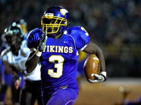 Tarboro Vikings running back Quentin Robertson (3) runs the ball  during tonights game. Tarboro defeats South Columbus 46-0  in Tarboro,North Carolina.   (Photos By Anthony Barham)